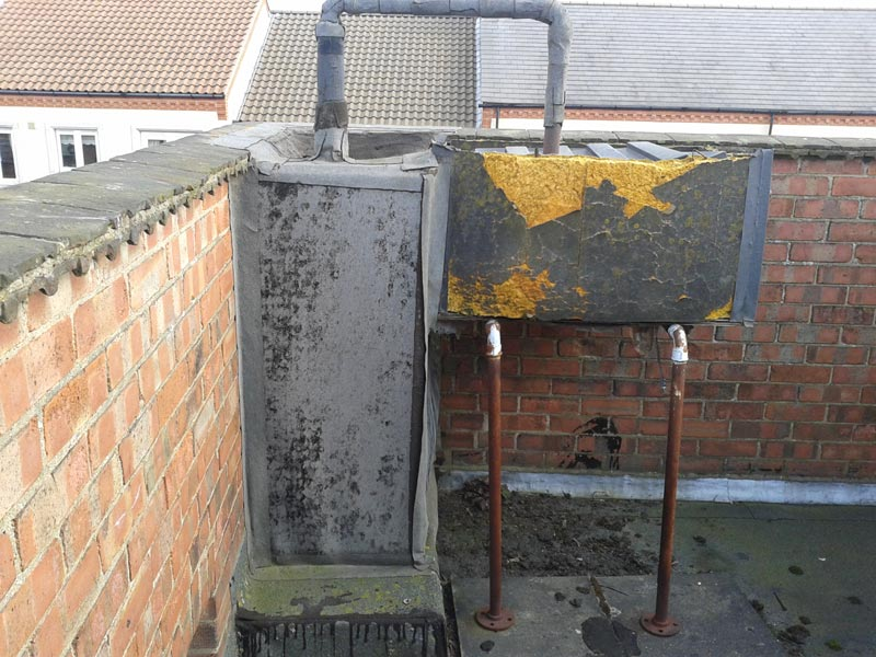 Before: Failed water tank housing. Leaking to upstands & pipework.