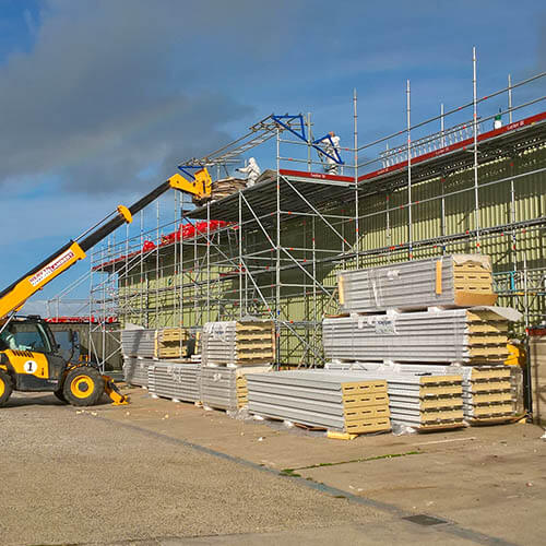 A telehandler used to unload and crane into position on the roof to reduce manual handling Independent platform scaffold complete with strategically placed loading bays. All complying with structural loading calculations and to HSE Recommendations and NFRC 33 regulation r (see above)