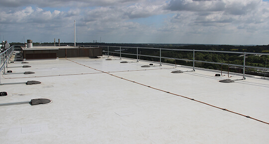 New insulated single ply roof installed by Belmont Roofing for City College complete with a permanent fall restraint system.